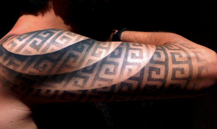 Optical illusion tattoo arm